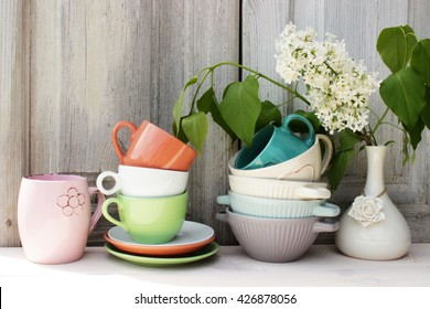 Kitchen shelf with vintage dishware in a cozy rustic setting. Retro style. Tender, pastel color