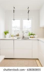 kitchen sink by the window in fancy kitchen interior