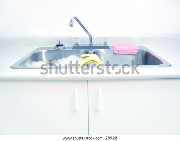 A kitchen sink with cleaning supplies. Blue tones.