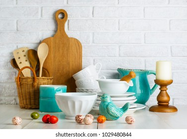 Kitchen still life with ceramic bird and easter eggs and utensils