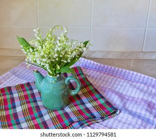 Kitchen still life with Convallaria