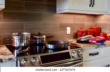 Kitchen stove with pots and pans after making family meal for sharing