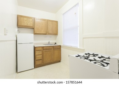A kitchen in a studio apartment