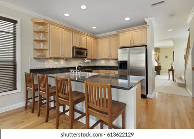 Kitchen in suburban home with oak cabinetry.
