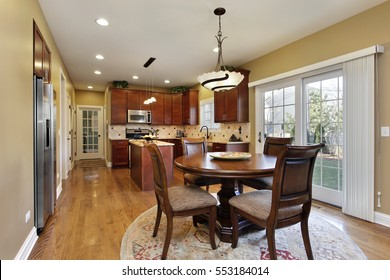 Kitchen in suburban home with round table.