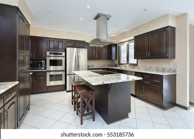 Kitchen in suburban home with stove-top island.