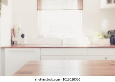 kitchen surface with bright blurred kitchen interior background