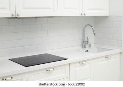 Kitchen table with built-in sink and electric stove