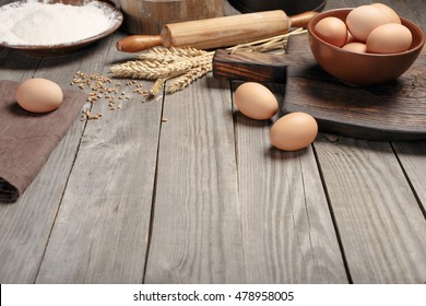 Kitchen table with ingredients for cooking baking with blank place for your product