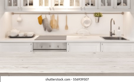 Kitchen table top and blur background of cooking zone interior