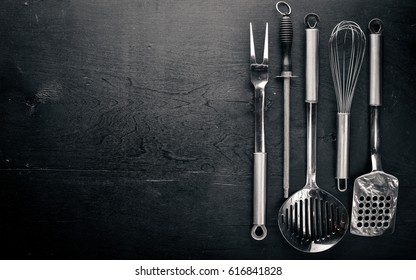 Kitchen tools. On Wooden background. Top view.