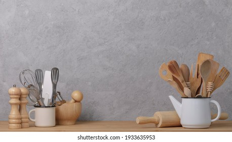 Kitchen tools, utensils and kitchenware on the table on a grey concrete background. Selective focus.