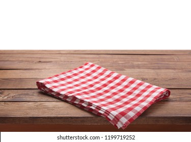 Kitchen towel on empty wooden table on white background. Napkin close up top view mock up for design. .