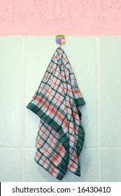 Kitchen towel on stucco and tiled wall.