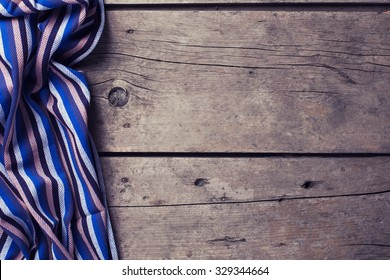 Kitchen towel  on vintage  wooden background. Selective focus. Place for text. Toned image.
