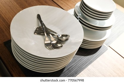 Kitchen Utensil, Collection of White Ceramic Plates, Bowls and Cutlery, Preparing for Special Dinner or Lunch.