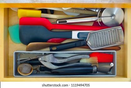 kitchen utensil drawer disordered