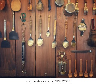 Kitchen utensil are hanging on the wooden wall