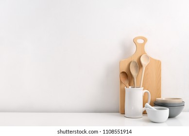 Kitchen utensils background with a blank space for a text, home kitchen decor concept, front view