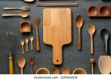 kitchen utensils for cooking on the black table background, food prepare concept