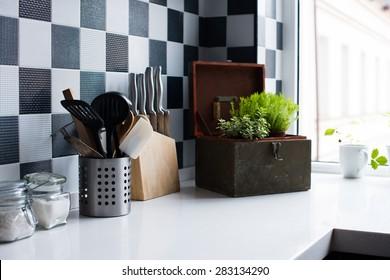 Kitchen utensils, decor and kitchenware in the modern kitchen interior close-up