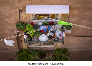 Kitchen utensils with dishes on an outside wall