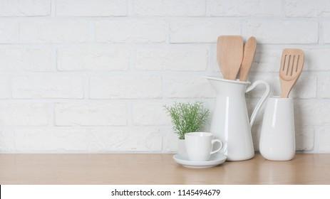 Kitchen utensils and dishware on wooden shelf. Kitchen interior background.Text space.