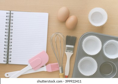kitchen utensils for making muffin and notebook for write recipe, image soft tone and soft focus