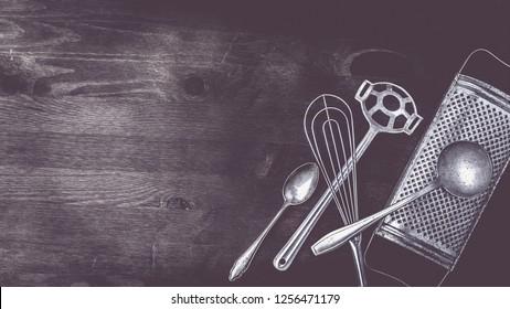 Kitchen utensils on a dark wooden background