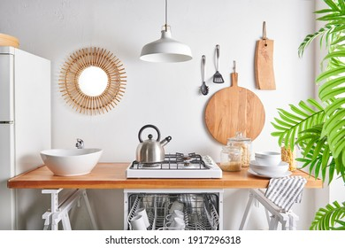 Kitchen utensils on the wall cutting board fork sink lamp style.