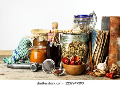 Kitchen utensils on a wooden table. White background. Food preparation. Cookbook and cooking ingredients. Old book.