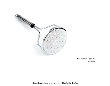Kitchen utensils, potato masher on a white background. Side view with space for copying. The concept of cooking.