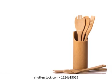 Kitchen utensils set isolated on white background. Wooden spoons, spatulas in stand. Cooking workshop, kitchenware, advertising in food industry, menu, brochure for restaurants concept. Copy space