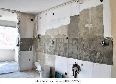 Kitchen wall during reconstruction work without door, tiles and tap. Home improvement. Home repairing