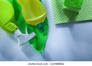 Kitchen washcloth bottles sprayer sponge on white background.