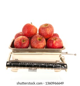 Kitchen weight scale fresh red apples isolated over white background