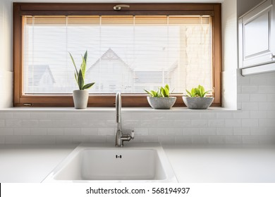Kitchen with white sink, countertop and window
