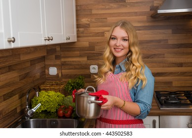 kitchen woman making healthy food standing happy smiling in kitchen preparing salad