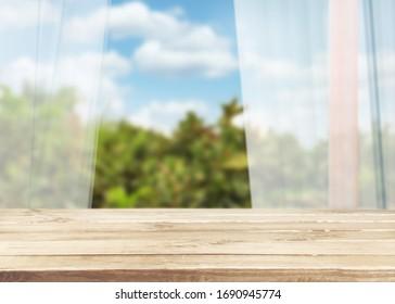 Kitchen wooden table on blur window background