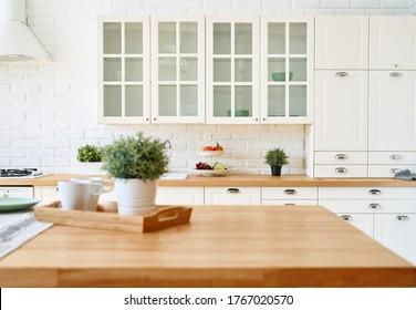 Kitchen wooden table top and kitchen blur background interior style scandinavian - Shutterstock ID 1767020570
