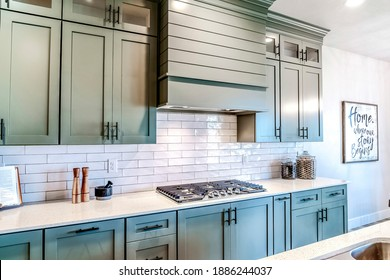 Kitchen work station with cooktop built on countertop with exhaust hood above