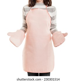 Kitchen working housewife concept - beauty woman wearing food cooking apron and oven mitt white isolated