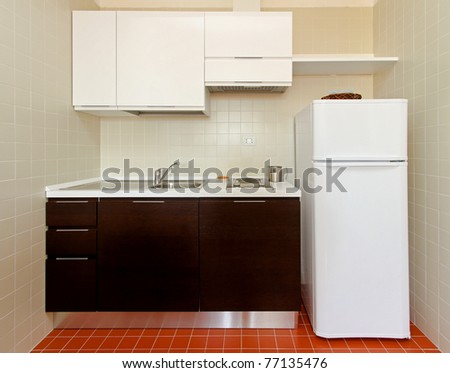 Kitchenette With All Appliances In Small Apartment