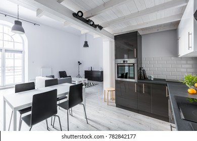 Kitchenette and dining space in open plan loft apartment