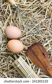 Kitchenware and eggs on straw(Emulsifying and Wood Spatula)