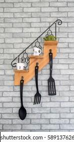 Kitchenware hanging on hook, Interior design