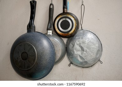Kitchenware on the wall .