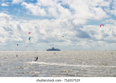 Kite action with ferry in the background on island Ameland (Netherlands)