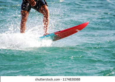 Kite boarder sailing.