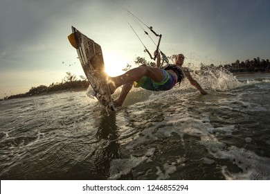 Kite Boarder in sunset catching a wave
